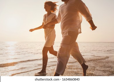 romantic getaway travel, happy couple on the beach having fun, honeymoon tourists on summer holidays