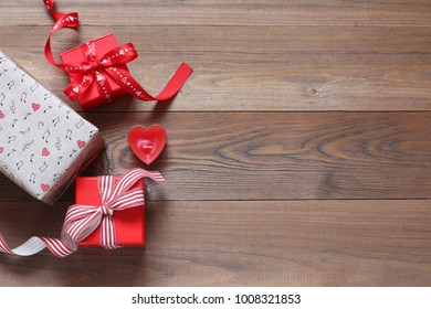 Romantic gifts on a wooden table