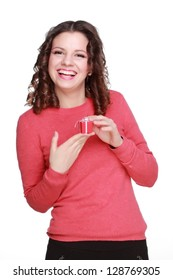 Romantic girl in a red sweater holding a small box of red color