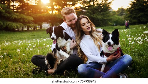 Romantic happy couple in love enjoying their time with pets in nature