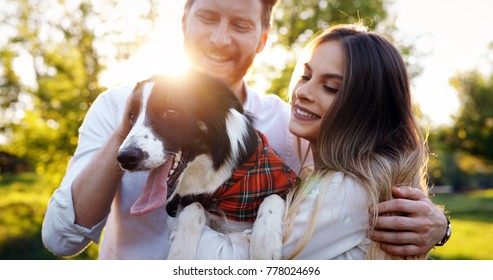 Romantic happy couple in love enjoying their time with pets