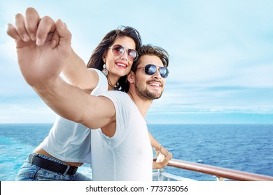 Romantic happy couple on a cruise ship,  embracing and smiling