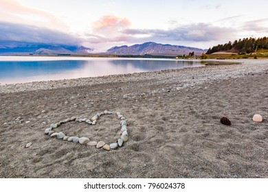 Romantic heart shape with beautiful landscape over sunset