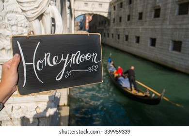 Romantic Honeymoon sign in the canal in Venice