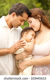 Romantic Intimate Portrait of Indian Father, Caucasian Mother and Baby Son