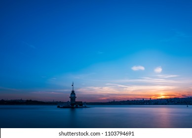 Romantic Istanbul Sunset Landscape. Istanbul Bosphorus and Maiden's Tower view with beautiful blue romantic sky. Istanbul, Turkey.