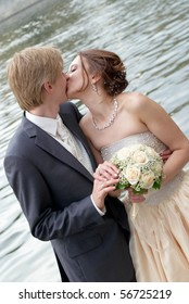 Romantic kiss of the bride and the groom