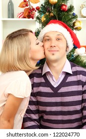Romantic kiss under mistletoe
