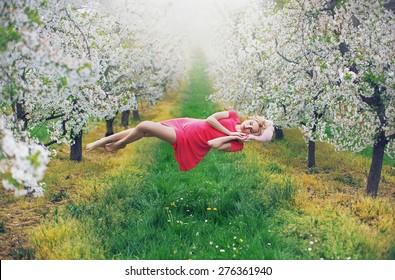 Romantic levitating blonde beauty