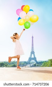 Romantic little girl with bright balloons in Paris