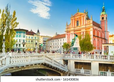Romantic Ljubljana's city center:  river Ljubljanica, Triple Bridge (Tromostovje), Preseren square and Franciscan Church of the Annunciation; Ljubljana, Slovenia, Europe.