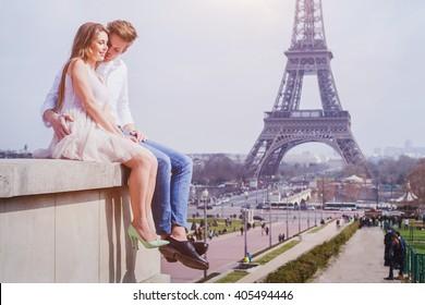 romantic love, affectionate couple sitting near Eiffel Tower in Paris, honeymoon in Europe