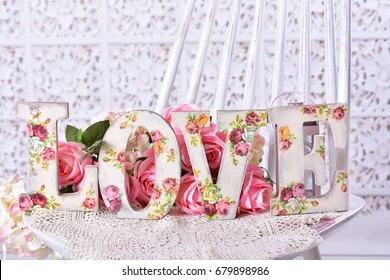 romantic love background with vintage style decoupage decorated letters with rose pattern