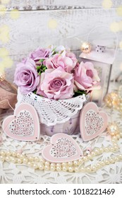 romantic love decoration with hearts,roses and lanterns in shabby chic style for wedding or valentine`s day