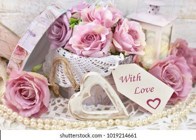 romantic love decoration with paper label, hearts,roses and lanterns in shabby chic style for wedding or valentine`s day