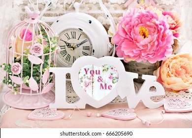 romantic love decoration in shabby chic style with letters,flowers,vintage clock and bird cages