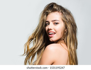 Romantic and love. Happy beautiful girl - face portrait close up. Sensual beauty woman with beautiful face posing - isolated on gray. Gorgeous female portrait. Beauty girl with healthy skin