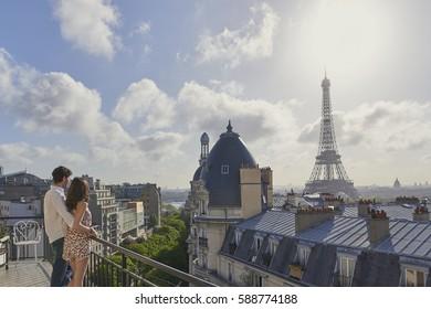 Romantic in love man woman couple in Paris Eiffel Tower embrace honeymoon destination