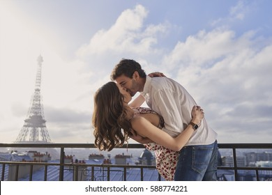 Romantic in love man woman couple in Paris Eiffel Tower embrace kissing honeymoon destination