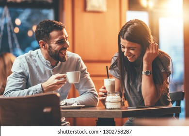Romantic loving couple drinking coffee, having a date in the cafe.