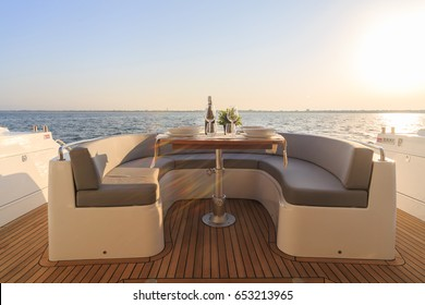 romantic lunch on motor yacht at sunset, Table setting at a luxury yacht.