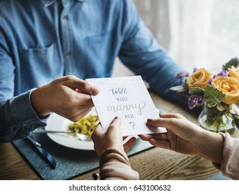 Romantic Man Giving Will You Marry Me Card Propose Woman