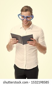 Romantic man learn poetry by heart. Romantic ideas for valentines day. Romantic poetry concept. Man handsome well groomed guy wear heart shaped glasses and hold book. Macho read romantic poetry.