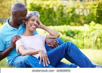 Romantic Mature Couple Sitting In Garden