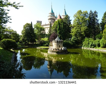 romantic medieval Bojnice castle (Bojnicky zamok) reflected in water of pond in garden, famous touristic attraction and popular movie set for fairy tales and fantasy films, Slovakia, Central Europe
