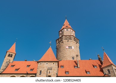 "Romantic Medieval Castle ""Bouzov"", Czech Republic and a background of the blue sky. The orange roof and blue sky makes nice contrast. Located in the South Moravia region. Europe. Tourism in Europe."