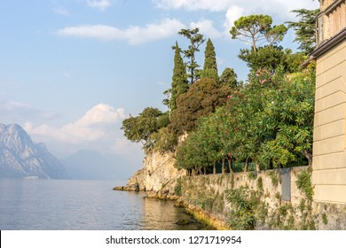 Romantic mediterranean landscape in Malcesine on Lake Garda with cypresses and mountains