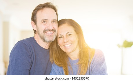Romantic middle age couple sitting together at home