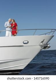 Romantic middle aged couple enjoying drinks on yacht