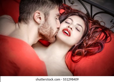 Romantic moment between a man and a woman with red lipstick