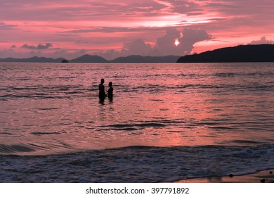 romantic moment on beach at sunset ,pink tone ,Artistic