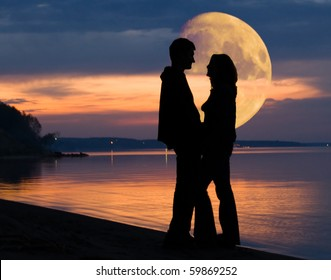 Romantic mood and couple and huge Moon behind