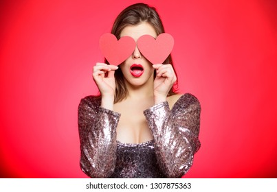 Romantic mood. Girl in love dating. Obsession concept. Fall in love. Girl adorable fashion model makeup face hold heart valentines card. Love from first sight. Woman in stylish dress hold symbol love.
