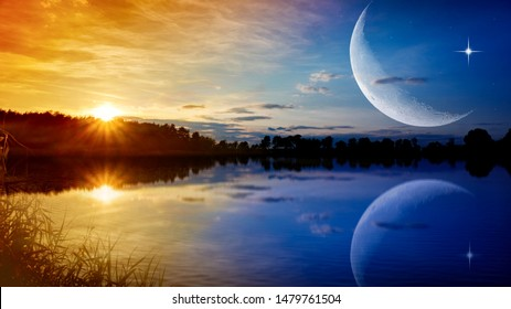 the romantic moon over water . Crescent moon with beautiful sunset background . Generous Ramadan . New moon.