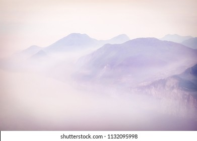Romantic morning mood on Monte Baldo with views of Lake Garda and its western shore in early morning fog, Italy