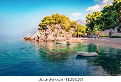 Romantic morning seascape of Adriatic sea. Colorful summer view of small beach in famous resort - Brela, Croatia, Europe. Beautiful world of Mediterranean countries.