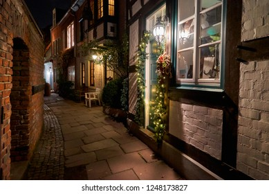 romantic narrow street with christmas decoration in the historic quarter Schnoor in Bremen (Germany) at night