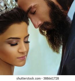 Romantic newlywed couple, beautiful bride & handsome groom face closeup