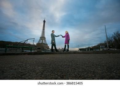 Romantic newlywed couple walking near the Eiffel Tower