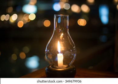 Romantic night with candlelight and bokeh background. New year and chirstmas or romantic valentine Day.