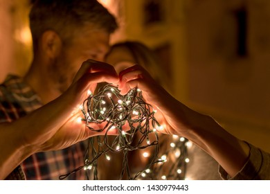 romantic night couple in old town with lights