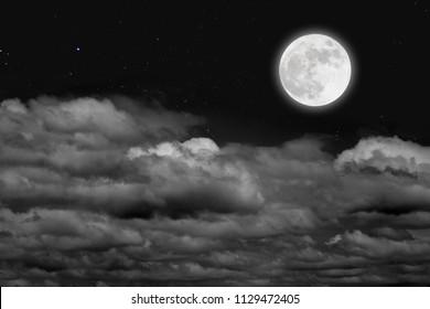 Romantic night. Full moon  over cloudscape.