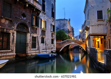 Romantic night view of a venetian canal, Venice, Italy