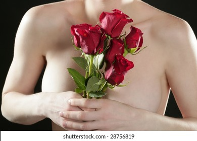 Romantic nude woman in love holding red roses in hands