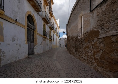 A romantic old alley with Buildings on the left and right side and a lantern at the End