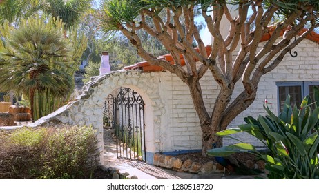 Romantic old archway with iron gate at a historic California ranch built in the 1930's